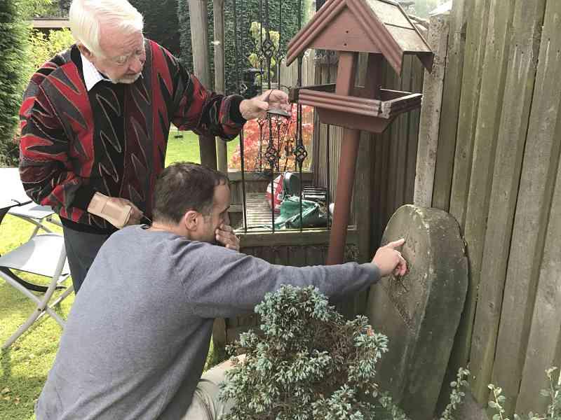 Stonemason Daniel Cooper with Titus Salts dog Puck memorial stone